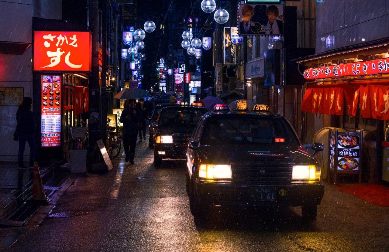 photo of cars in the street